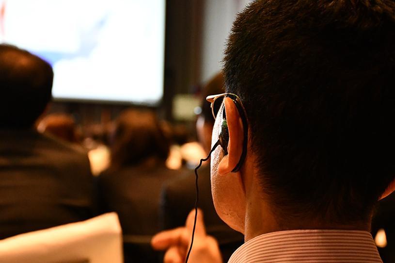 Man listening to translator
